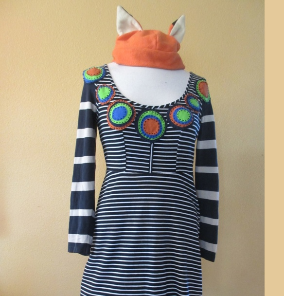 This cotton and stretch fiber sports dress was resized and sleeves added. It was appliquéd with stacked, tee shirt circles. Maker: Melinda Forbes