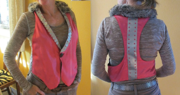 This pink vest is the second attempt. It is made from a ball gown, reflective tape, and a faux fur scarf.  Although it is pretty cool, Liz decided that she could do better if she tried again.  The inside seems were still sticking out and the lapels were disjointed. The fur collar hides the lapel issues.